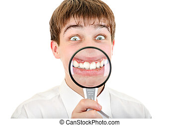 Funny Teenager with a Loupe - Funny Teenager holds a Loupe...