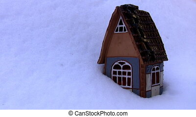 Christmas cottage with candle loop - A burning candle flame...