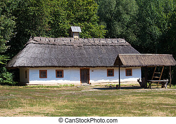 Wooden houses taken in park in summer in Pirogovo museum,...