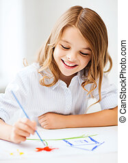 Little girl painting at school - education, school, art and...