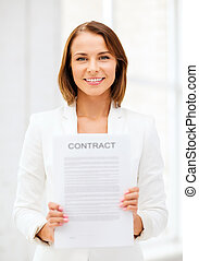 Businesswoman holding contract - business and real estate...