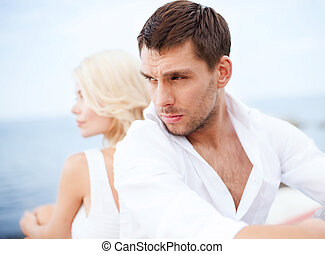 Stressed man with woman outside - summer holidays, dating...