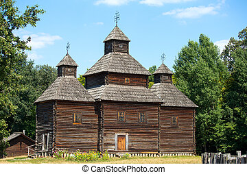 Wooden ukrainian antique orthodox church in summer in...