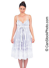 Seductive young model in summer dress posing