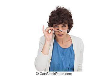 Shocked woman looking over her glasses