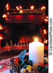 Christmas candle and decorations. - White candle with...