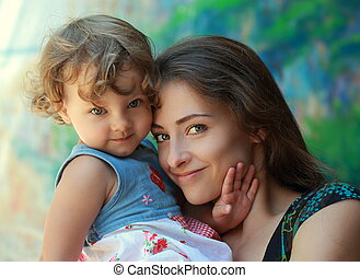 Beautiful smiling mother and happy fun kid girl looking. Closeup portrait