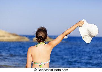 Woman in hat is posing