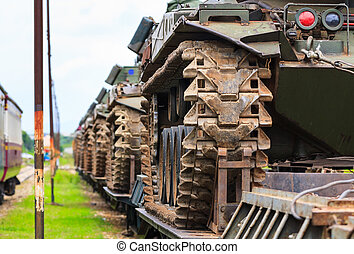 Military tanks. - Close-trains carrying military tanks...
