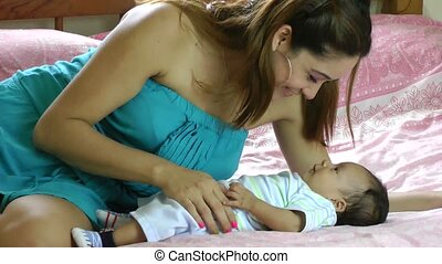 young hispanic woman playing with h