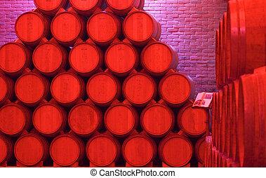 Red Barrels - Pile of barrels of wine under red light