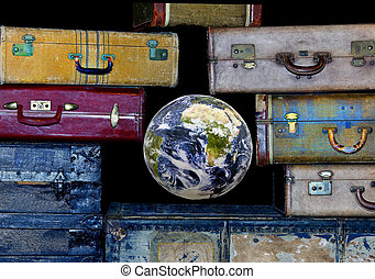 World Travel - Earth in the middle of antique suitcases...