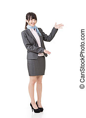 Attractive business woman showing or introducing something...