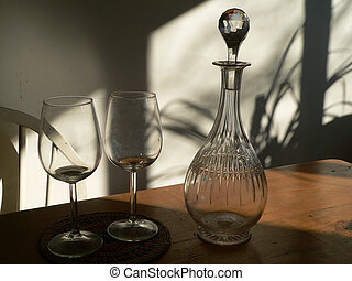 shadows - empty wine glasses placed next to a crystal carafe...
