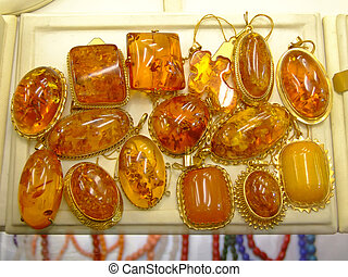 Amber - Gem stone pendants made of modified amber and gold