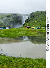 tent camp near Skogarfoss waterfall in Iceland, summer