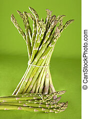 green vegetables - fresh green bunch of asparagus on green...