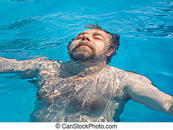 Middle-aged man in a swimming pool