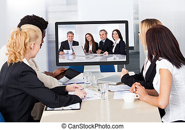 Video conference in the office - Group of male and female...