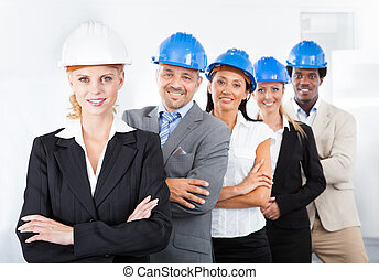 Group Of Happy Multiracial Architects Standing In A Row