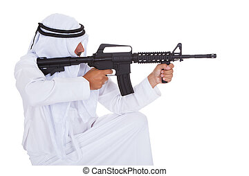 Happy Mature Islamic Man Holding Gun Over White Background