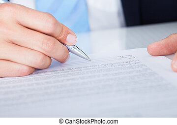 Businessman Signing Contract Paper - Close-up Of Businessman...