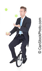 Happy Businessman Juggling