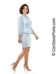 business woman walking - beautiful brunette wearing blue...