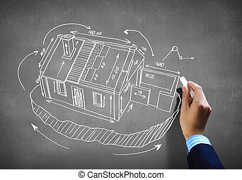House sketch - Close up image of human hand drawing house...