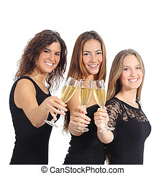 Beautiful group of three women toasting with champagne...