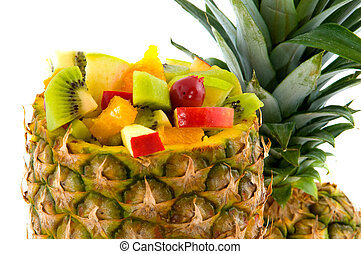 Tropical mixed fruit salad in pineapple