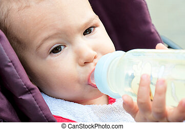 Baby drinking - Little baby drinking water from the bottle