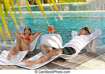 happy young couple relax and take fresh drink at summer...
