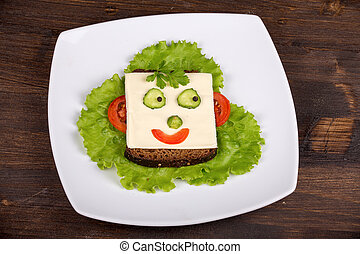 Fun food for kids - face on bread, made from cheese,...