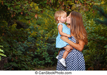 Family, mother and daughter - Mother holds daughter in his...