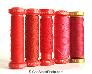 Red sewing threads spools