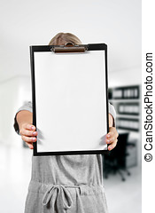 woman hold a blank clipboard in the office