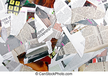 background with variety of different torn newspapers and...
