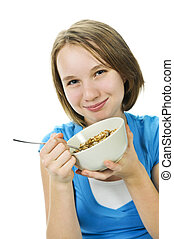 Girl eating cereal - Young girl holding bowl of cereal with...