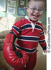 Little boy boxing - Little boy playing with boxing gloves.