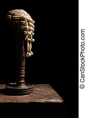 Judge wig on stand - Old wooden stand with an authentic...