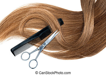 hairdressing - Professional hairdresser scissors and comb on...