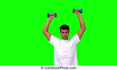 Man lifting dumbbells on green screen in slow motion