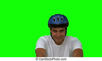 Man on his bicycle on green screen