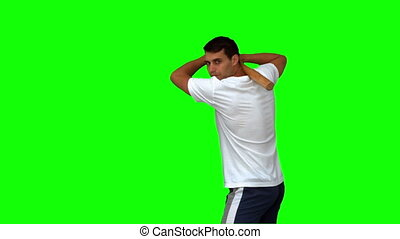 Man playing baseball on green screen in slow motion