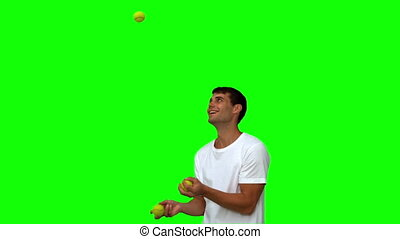 Man dribbling with balls on green screen in slow motion
