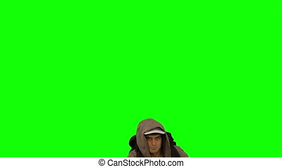 Man with a hiking stick jumping on green screen in slow...