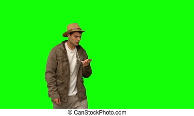 Lost man using a compass on green screen in slow motion