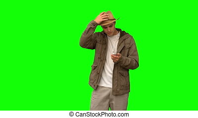 Lost man using his compass on green screen in slow motion
