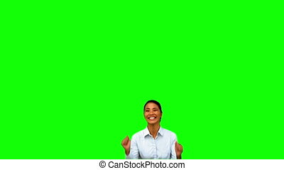 Cheerful businesswoman raising arms on green screen in slow...